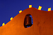 Light Decorations over the Bell on a House Facade in Santa Fe, New Mexiko, USA