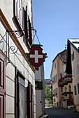 House with swiss flag emblem, Guarda, Grisons, Switzerland