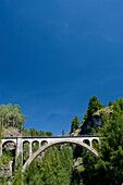 Viaduct under bright blue sky, Grisons, Switzerland
