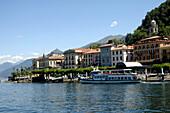 An excursion boat driving along the lake shore, Bellagio, Lago di Como, Lombardia, Italy