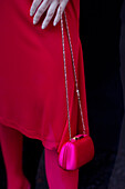 Mannequin in red dress with handbag in shop display