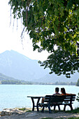 Couple relaxing on bench, Bad Wiessee, Bavaria, Germany