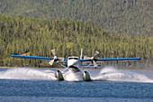 Plane landing on a lake, Canada