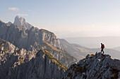 Climber on summit of Donnerkogel, Dachstein Mountain, Austria