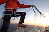 Climber handling rope on Schober Mountain, Salzburger Land, Österreich