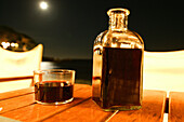 Costa Brava,Glass and Bottle of Wine, Moonlight, Beach at Calella, Costa Brava, Catalonia Spain