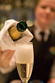 Pouring Welcome Champagne at Champagne Bar,Freedom of the Seas Cruise Ship, Royal Caribbean International Cruise Line
