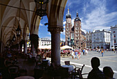 Market Square in Cracow, View from Cloth Hall toward Church of Virgin Mary in Cracow, Poland