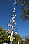May pole at Viktualienmarkt in Munich, Bavaria, Germany