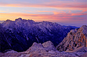 Romantic sunset sky and alpenglow, view from the hut Kredarica or Triglavski Dom, Triglav Nationalpark, Julian Alps, Slovenia, Alps.