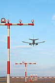 Aircraft above Approach Lights short before Landing, Airport Düsseldorf, North Rine-Westphalia, Germany