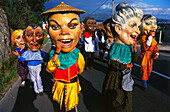 Procession of giant heads, village festival, San Juan de Poio, Province Pontevedra, Galicia, Spain