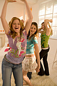 Four teenage girls (14-16) dancing