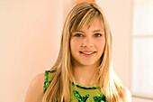 Teenage girl (14-16) smiling, portait