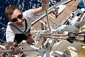 Man climbing a mast on the Star Clipper, Caribbean Sea