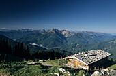 Alpine pasture and hut, Wildfeldalm, with view towards Schinder, Bavarian Alps, Upper Bavaria, Germany