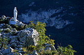 Madonna statue made from white marble on a cliff, Monte Colodri, Trentino, Italy