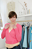 Young woman trying clothes in shop