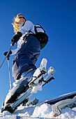 Young woman with touring skis, Davos, Grisons, Switzerland
