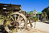 Old wagon, wheel and main building of Canon Lodge, Gondwana Canon Park, Fish river canyon. Southern Namibia. Africa.