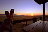 Laziness on porch of bungalow at Eagles Nest, Gondwana restricted area Rand Park. Succulent Karoo Desert, Namibia