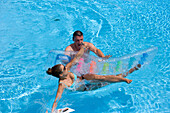 Man throwing woman from air mattress, Apulia, Italy