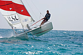 Man sailing on catamaran, Apulia, Italy