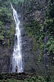 Woman at Vaimahuta Cascade Waterfall,Tahiti, French Polynesia