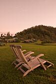 Lawn Chairs and Sea Ranch Cottages at Dawn,Hotel Hana-Maui, Hana, Maui, Hawaii, USA