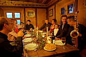 People having christmas dinner in traditional dinning room, St. Moritz, Switzerland