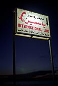 Illuminated sign at night, Luxor, Egypt