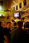 People in irish pub Pogue Mahones, Bolzano, Alto Adige, Italy