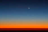 Crescent of moon above Horizon after sunset