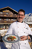 Chef serving a meal, Hotel and Restaurant Hohnegg, Saas-Fee, Valais, Switzerland
