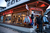 Person entering a sports outfitters, Saas-Fee, Valais, Switzerland