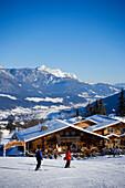 View over alpine hut and restaurant to Dachstein Mountains, Hochwurzen, Ski Amade, Schladming, Styria, Austria