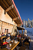 People resting in front of mountain restaurant, Planai, Schladming, Ski Amade, Styria, Austria