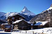 Bus at bus stop, Zermatt village with the Matterhorn (4478 metres) in the background, Zermatt, Valais, Switzerland