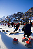 People curling on rink, Matterhorn in background, Zermatt, Valais, Switzerland