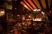 Waiter setting the table in the Restaurant Portofino, the first class restaurant of Hotel Post, Zermatt, Valais, Switzerland
