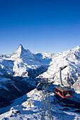 Overhead cable car going downhill from Rothorn, Matterhorn in background, Zermatt, Valais, Switzerland