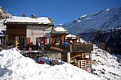 People sitting on terrace of Restaurant Paradies (2540 m), Findeln, Zermatt, Valais, Switzerland