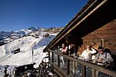 People sitting on terrace of Restaurant Chez Vrony, Design by Heinz Julen (2080 m), Findeln, Zermatt, Valais, Switzerland