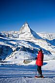 Skier on mountain slope, Matterhorn (4478 m) in background, Zermatt, Valais, Switzerland