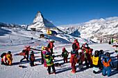 Children learning skiing, Matterhorn (4478 m) in background, Zermatt, Valais, Switzerland