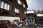 People resting on terrace of Restaurant Zum See, Zum See, Zermatt, Valais, Switzerland