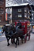A carriage passing a street in Zermatt, Valais, Switzerland