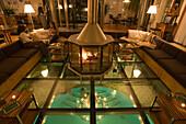 People sitting on lounge in the lobby of the hotel Coeur Des Alpes, design by Heinz Julen, Zermatt, Valais, Switzerland