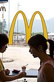 Teenagers at Hong Kong McDonald's, Lantau Island, Hong Kong