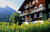 Traditional farmhouse with flower decorations, Kals, Glockner range, Hohe Tauern, East Tyrol, Tyrol, Austria